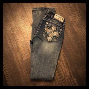 Jeweled pockets grace jeans sz. 25. Bootcut.